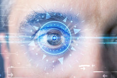 Cyber man with technolgy eye looking into blue Royalty Free Stock Photography