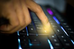 Cyber, Men`s hand on the keyboard who are hacking the security system royalty free stock photos