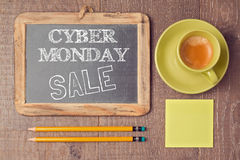 Cyber Monday on chalkboard with coffee cup. Holiday online shopping concept. View from above. Cyber Monday on chalkboard with coffee cup. Holiday online shopping stock photography