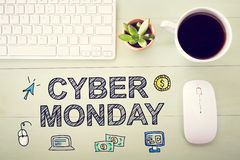 Cyber Monday message with workstation. On a light green wooden desk stock images
