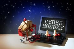 Cyber monday online shopping, christmas baubles and gift boxes i Stock Image