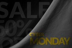 Cyber Monday Promotional Concept on Fabric background Royalty Free Stock Photos