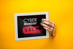 Cyber monday sale concept. With female hands and tablet Stock Photo