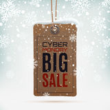 Cyber Monday sale. Realistic, vintage price tag on winter background wit snow and snowflakes. Vector illustration. Royalty Free Stock Images