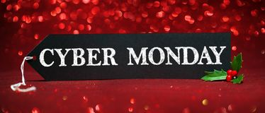 Cyber Monday sale tag. On red glitter background Stock Images