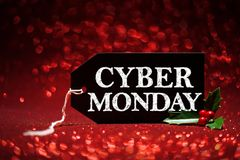 Cyber Monday sale tag. On red glitter background Stock Photo
