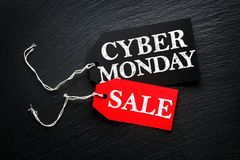 Cyber Monday Sale tags. On dark background Royalty Free Stock Photo