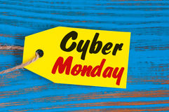 Cyber monday sales tag on blue wooden background Royalty Free Stock Image