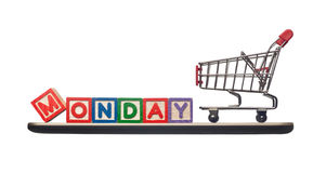 Cyber Monday. Shopping cart on a mobile phone with the word Monday depicting Cyber Monday royalty free stock image