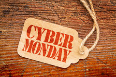 Cyber Monday sign on price tag. Cyber Monday sign - a paper price tag against rustic red painted barn wood Stock Photography