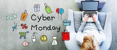 Cyber Monday text with man. Using a laptop royalty free stock photos