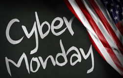 Cyber Monday written on blackboard and the USA flag Stock Photo