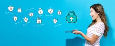 Cyber ochrona z kobietą używa pastylkę fotografia royalty free