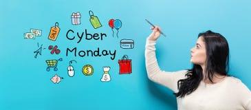 Cyber Poniedziałek z młodą kobietą trzyma pióro zdjęcia royalty free