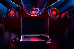 Free Cyber Safety And Data Leakage Concept: Computer And Other Devices Observed By Hostile Looking Cctv`s. 3D Rendering Royalty Free Stock Photography - 141985697