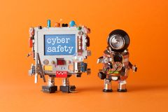 Cyber safety concept. System administrator robot and creative computer character with text message on blue desktop. Orange backgro. Cyber safety concept. System royalty free stock images