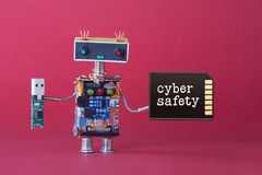 Cyber safety data storage concept. System administrator robot toy with usb flash stick and memory card on red background Royalty Free Stock Photography