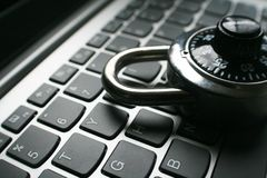 Cyber Security With Black Combination Lock On Laptop Keyboard Close Up High Quality. Stock Photo Stock Images