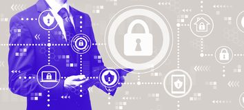 Cyber security with businessman holding a tablet stock photography