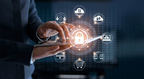 Cyber Security. Businessman using tablet technology. And icon customer network connection and exchange data on the virtual display. Cyber attack concept royalty free stock images