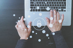 Cyber security internet and networking concept.Businessman hand. Working with VR screen padlock icon diagram on laptop computer Stock Image