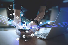 Cyber security internet and networking concept.Businessman hand. Working with VR screen padlock icon on mobile phone and laptop computer background Stock Image