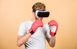 Cyber sportsman boxing gloves. Man play game in VR glasses. Cyber sport concept. Man boxer virtual reality headset stock images