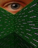 Cyber Stalking Spyware Eye. A large eye peering over walls of binary code Stock Image