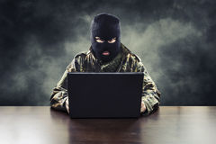 Cyber terrorist in military uniform Stock Image