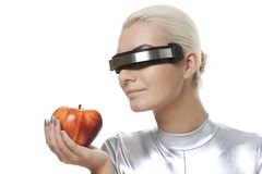 Cyber woman with an apple Royalty Free Stock Photography