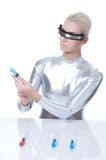 Cyber woman choosing syringe Stock Photography
