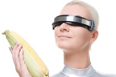 Cyber woman with a corn Stock Image