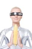 Cyber woman with a corn Stock Photos