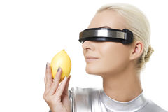 Cyber woman with fresh lemon Stock Photography