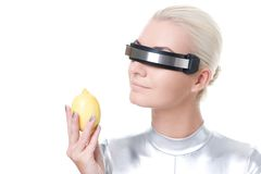 Cyber woman with fresh lemon Royalty Free Stock Image