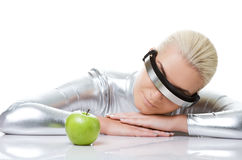 Cyber woman with a green apple Stock Photos