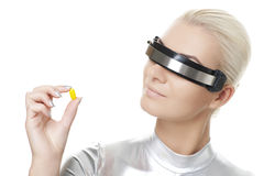 Cyber woman with a pill Stock Photos