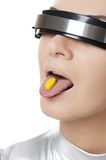 Cyber woman with a pill Royalty Free Stock Photography