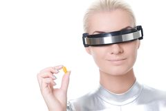 Cyber woman with a pill Royalty Free Stock Photo