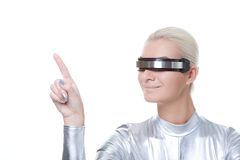 Cyber woman pointing at something Royalty Free Stock Image