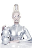 Cyber woman with silver balls. Beautiful cyber woman with silver balls royalty free stock photo