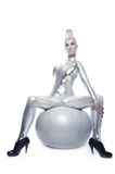 Cyber woman sitting on a silver ball Stock Photos