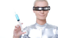 Cyber woman with syringe Royalty Free Stock Photography