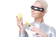 Cyber woman taking vitamins Royalty Free Stock Photography