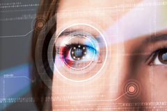 Cyber woman with technolgy eye looking Stock Photo