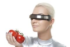 Cyber woman with tomatoes Royalty Free Stock Photos