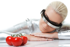 Cyber woman with tomatoes Royalty Free Stock Image