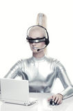 Cyber woman working on her laprop Stock Photography