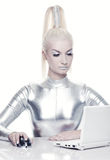 Cyber woman working on her laptop Royalty Free Stock Photo
