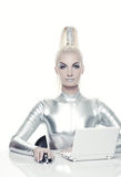 Cyber woman working on her laptop Stock Image